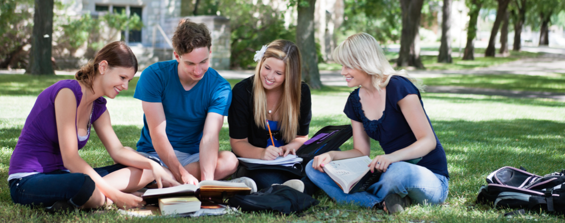 students-studying-on-the-grass